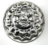 Moule à pâtisserie jouet en métal en forme de soleil.