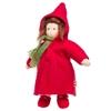 Voddenpop met bruin mohair haar en bruine ogen. Ze draagt een lange rode wollen mantel met capuchon, rode  wollen schoenen en een groene sjerp.