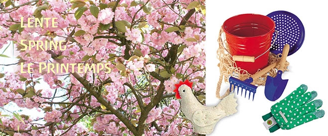 Japanese cherry blossom, next to a set of sand games, a pair of green gardening gloves for children and a small white felt hen.